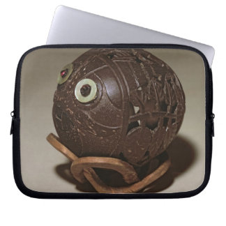 Coconut sculpted into a face, c.1895 laptop sleeve