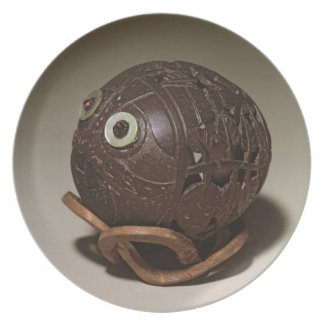 Coconut sculpted into a face, c.1895 melamine plate