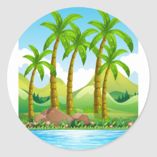 Coconut trees by the ocean classic round sticker