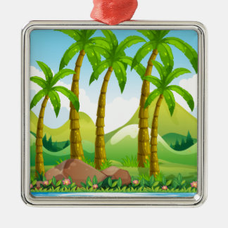 Coconut trees by the ocean metal ornament