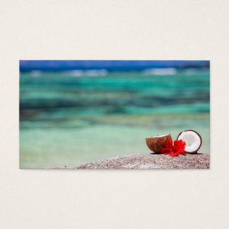 Coconut with tropical flower on exotic coast business card
