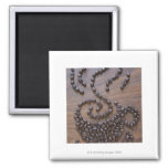 Coffe cup illustrated using coffee beans refrigerator magnet