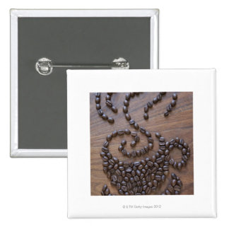Coffe cup illustrated using coffee beans pinback button