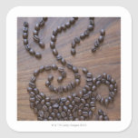 Coffe cup illustrated using coffee beans square sticker