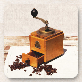coffee beans and old coffee mill coaster