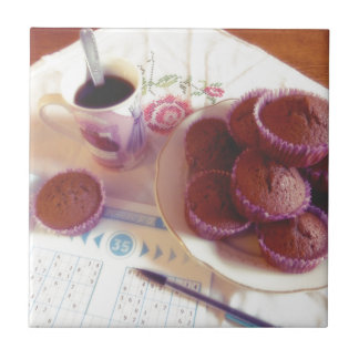 Coffee, chocolate muffins and reflection ceramic tile