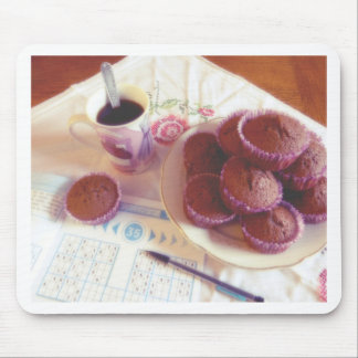 Coffee, chocolate muffins and reflection mouse pad
