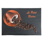 Coffee cup and spilled beans place mat