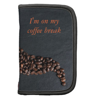 Coffee cup and spilled beans planners