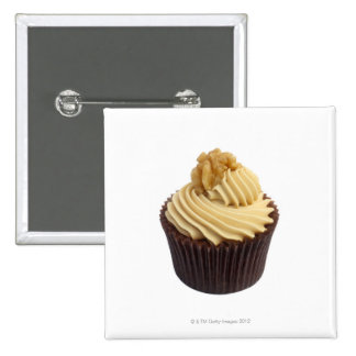 Coffee cupcake topped with coffee cream and a pinback button