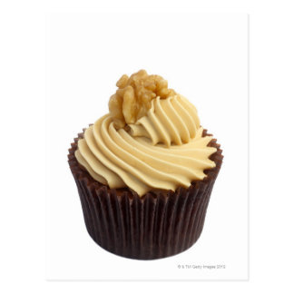 Coffee cupcake topped with coffee cream and a postcard