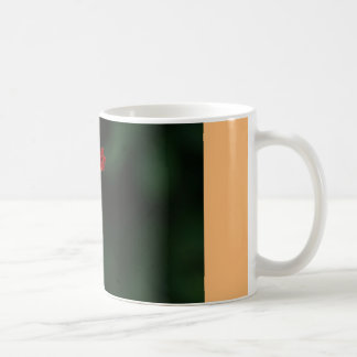 coffee mug with orange and red flower