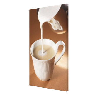 Coffee with milk being poured in canvas print