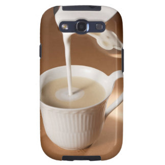Coffee with milk being poured in galaxy s3 cover