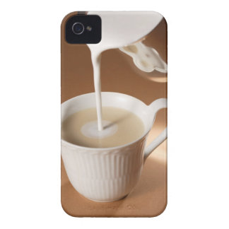 Coffee with milk being poured in iPhone 4 case