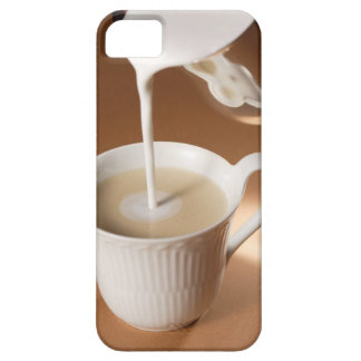 Coffee with milk being poured in iPhone 5 cover