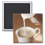 Coffee with milk being poured in refrigerator magnets