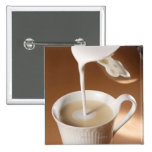 Coffee with milk being poured in pinback button