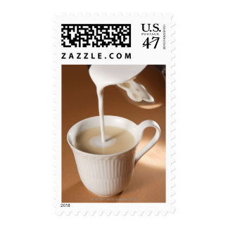 Coffee with milk being poured in postage
