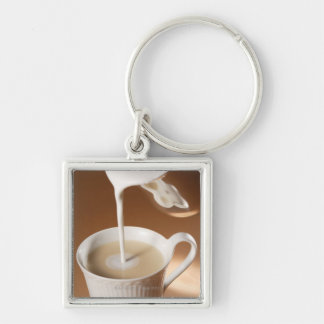 Coffee with milk being poured in Silver-Colored square keychain