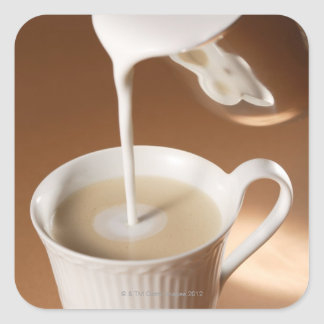 Coffee with milk being poured in square sticker