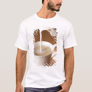Coffee with milk being poured in T-Shirt