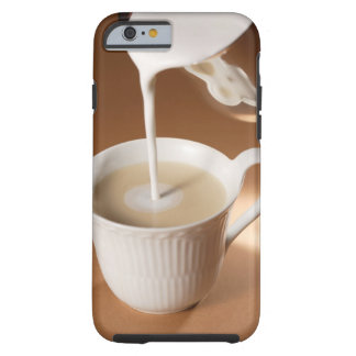 Coffee with milk being poured in tough iPhone 6 case