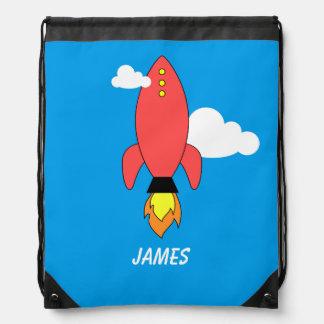 Cohete rojo del dibujo animado mochilas