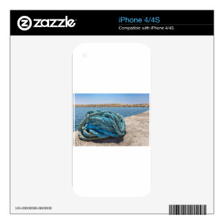 Coiled blue mooring rope at water in greek cave iPhone 4S decal