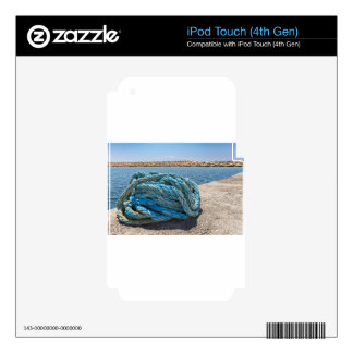 Coiled blue mooring rope at water in greek cave skins for iPod touch 4G
