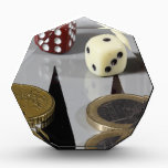 "Coins on a backgammon board award<br><div class=""desc"">Euro coins on a backgammon board.</div>"