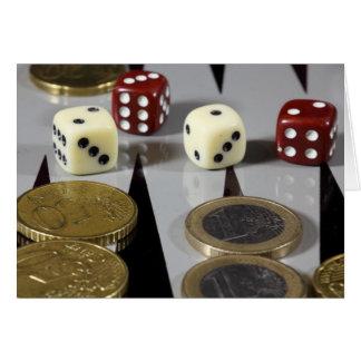 Coins on a backgammon board card