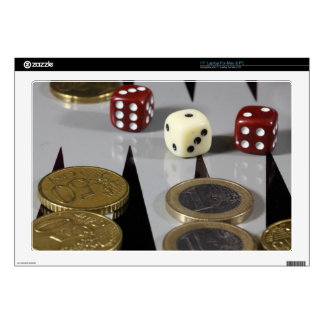 Coins on a backgammon board decal for laptop