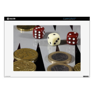 Coins on a backgammon board decals for laptops