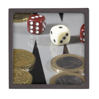 Coins on a backgammon board gift box