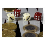 Coins on a backgammon board greeting card