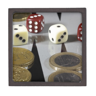 Coins on a backgammon board jewelry box