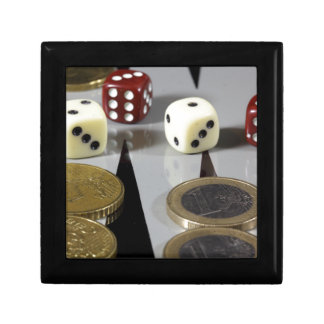 Coins on a backgammon board keepsake box