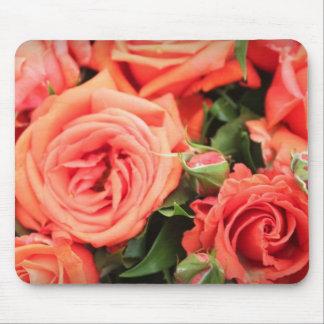 Cojín de ratón anaranjado de los rosas tapetes de ratón