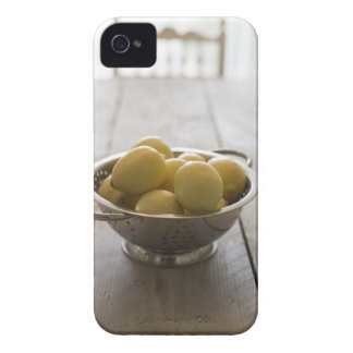 Colander with lemons on wooden table iPhone 4 case