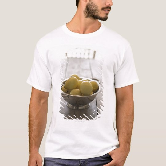 Colander with lemons on wooden table T-Shirt
