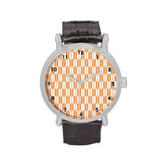 Colas anaranjadas y blancas de la flecha reloj