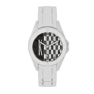 Colas negras y blancas de la flecha relojes de pulsera