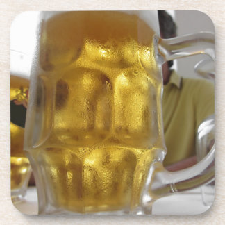 Cold mug of light beer on the table at a restauran coaster