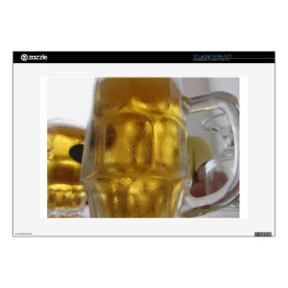 Cold mug of light beer on the table at a restauran laptop skin