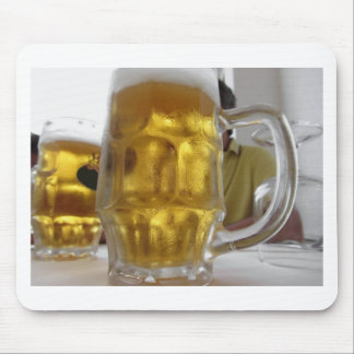 Cold mug of light beer on the table at a restauran mouse pad