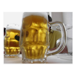 Cold mug of light beer on the table at a restauran postcard