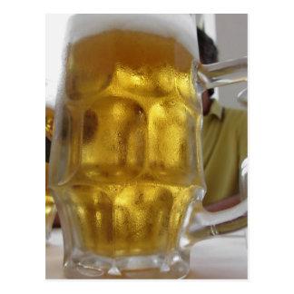Cold mug of light beer on the table at a restauran postcard