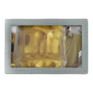 Cold mug of light beer on the table at a restauran rectangular belt buckle
