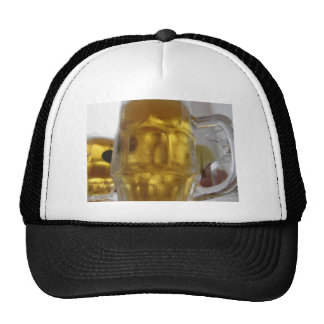 Cold mug of light beer on the table at a restauran trucker hat